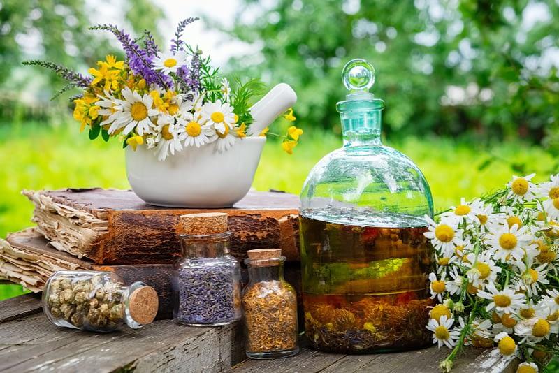 bigstock mortar of healing herbs bottl 277112125